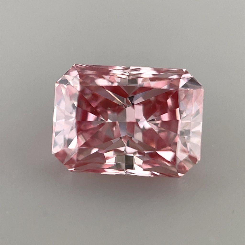Argyle pink diamond on a grey background