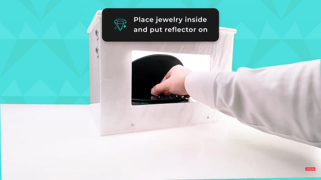 Place the jewelry inside the GemLightbox