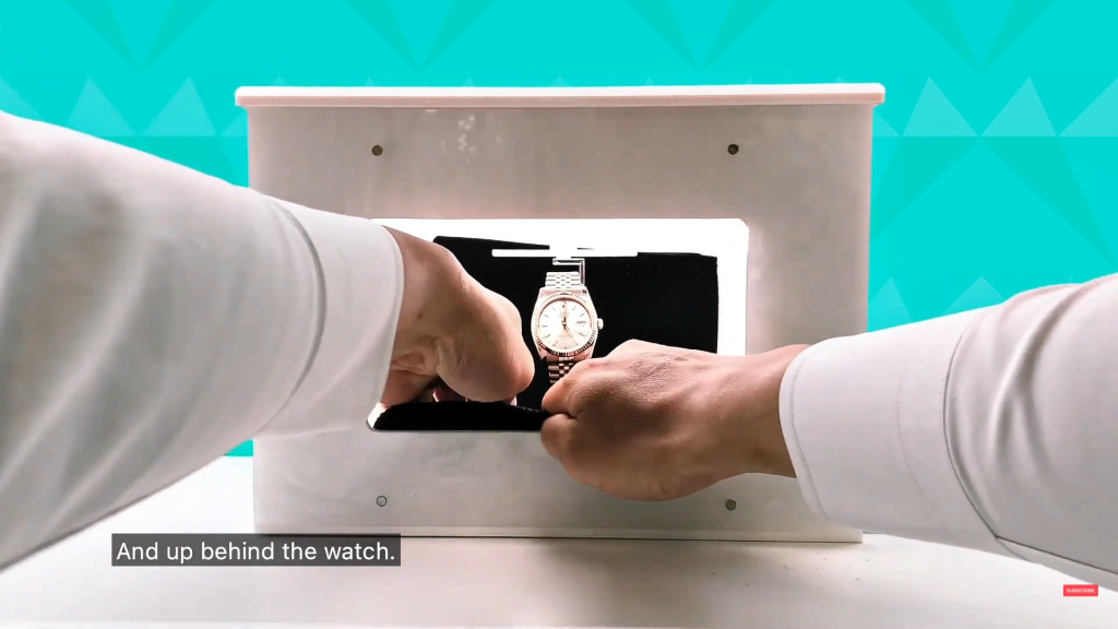 Capture the watch on a black background