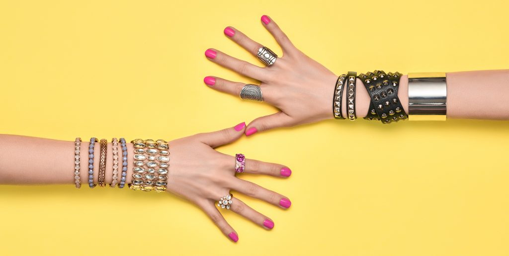 statement bracelets and rings in quantity